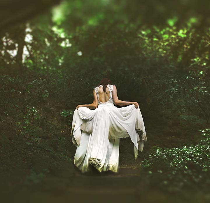 A woman in white in the woods